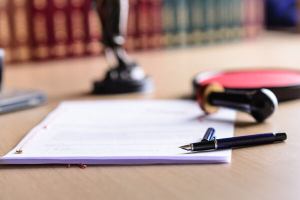 Trimnal & Myers, contract waiting for a notary public to sign on desk